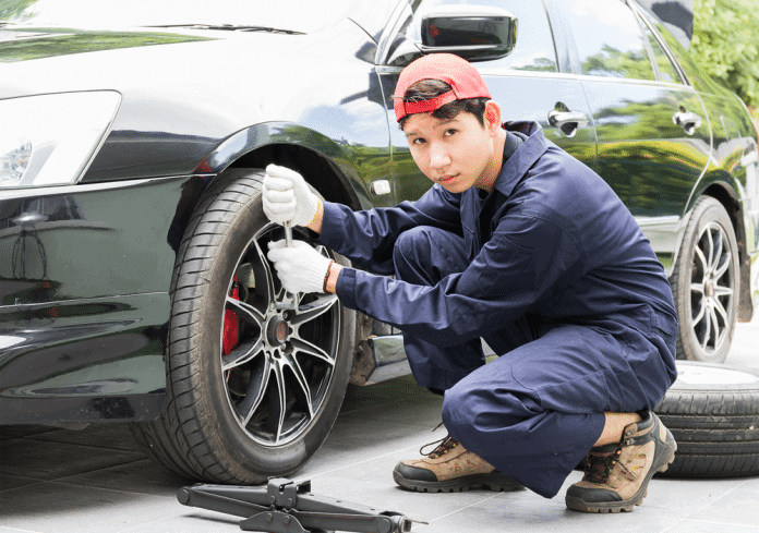 man showing how to break a lug nut off